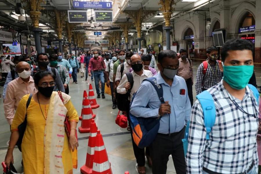 People wearing protective face masks leave the Chhatrapati Shivaji Terminus railway station, amidst the coronavirus disease (COVID-19) outbreak, in Mumbai, India on September 22, 2020 — Reuters photo