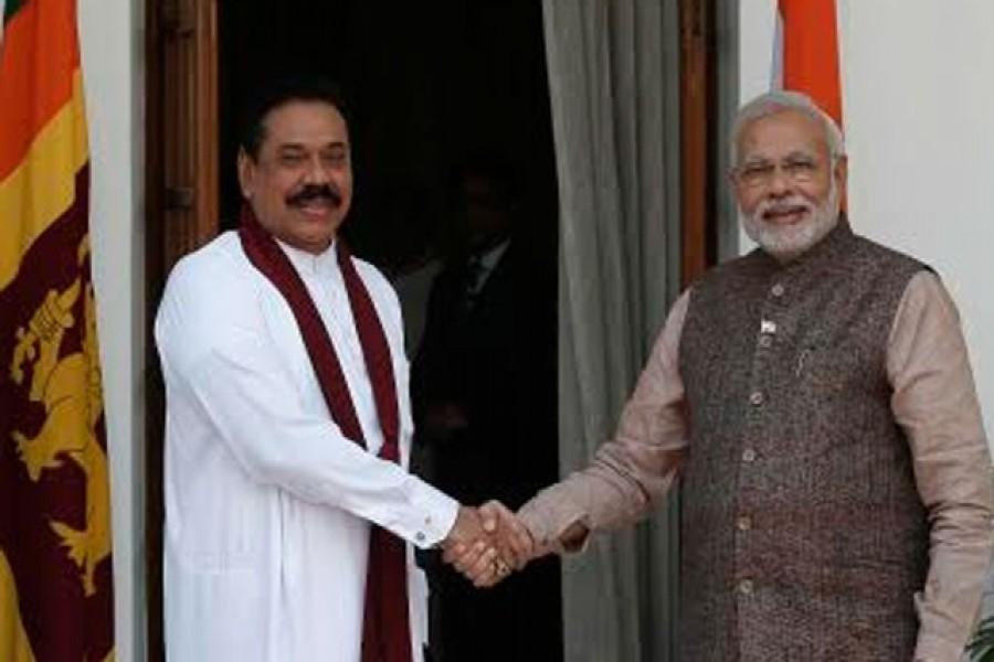 Sri Lankan leader Mahinda Rajapaksa met Narendra Modi during the Indian prime minister's oath-taking ceremony in 2014. Reuters