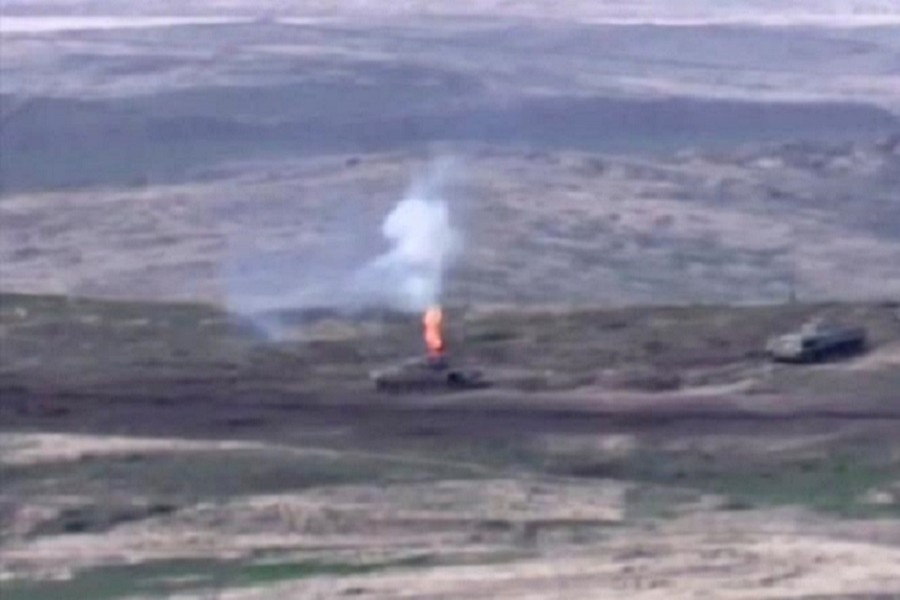 A still image from a video released by the Armenian Defence Ministry shows what is said to be Azerbaijani armoured vehicles, one of which is destroyed by Armenian armed forces in the breakaway region of Nagorno-Karabakh, in this still image from footage released September 27, 2020 — Defence Ministry of Armenia/Handout via Reuters